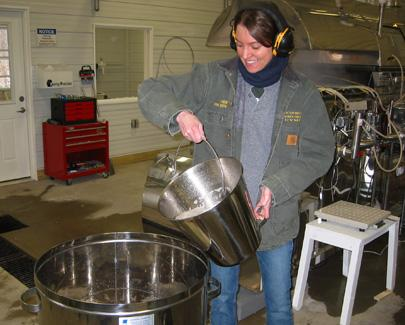 Abby van den Berg pours sap at Proctor Maple Research Center in Vermont